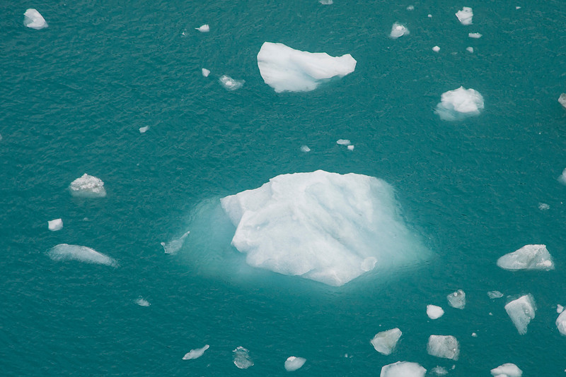 Up to 90% of icebergs' mass is beneath the surface, and you can get an idea of that here.