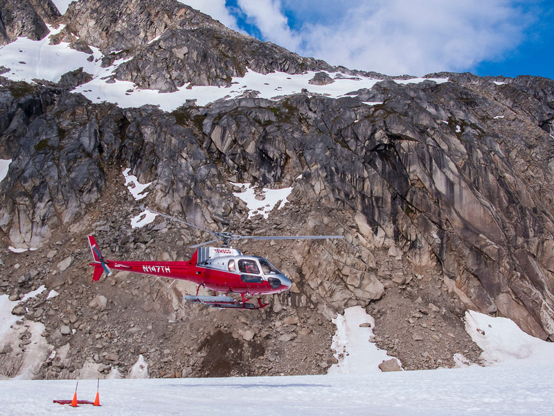Another chopper landing at summer sled-dog camp.