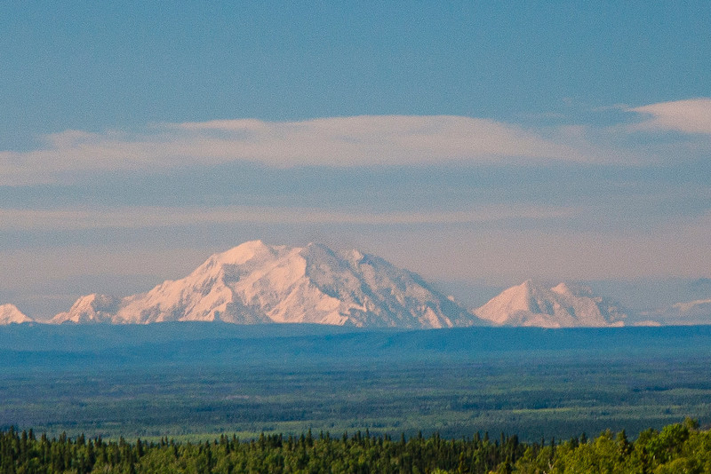 "Mount McKinley, which is normally covered by clouds (only one in three visitors actually gets to see it ""out"" like this).  Supposedly the tallest mountain in the world (from base to peak; Mt. Everest reaches a higher altitude, but its base isn't nearly as low)"