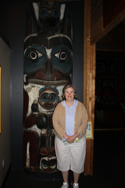 We started with a visit to the Alaska State Museum in Juneau, where Susan posed in front of a totem pole.