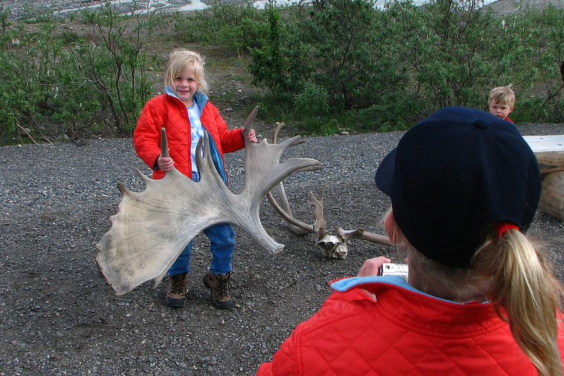 Liz hefts antlers at Toklat river.