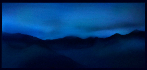 Michael's photo over looking cook inlet at night from the top of a ski resort.