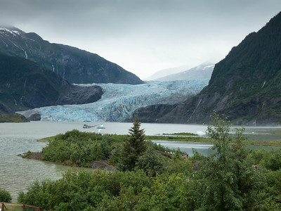 A trip is not complete without a view of the mighty Mendenhall Glacier in Juneau, Alaska.  The overcast cloudy day adds another depth of color to the already striking glacier blue.
