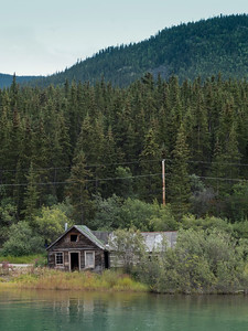 An abandoned house along the many rivers bordering the Denali National Park in Alaska.