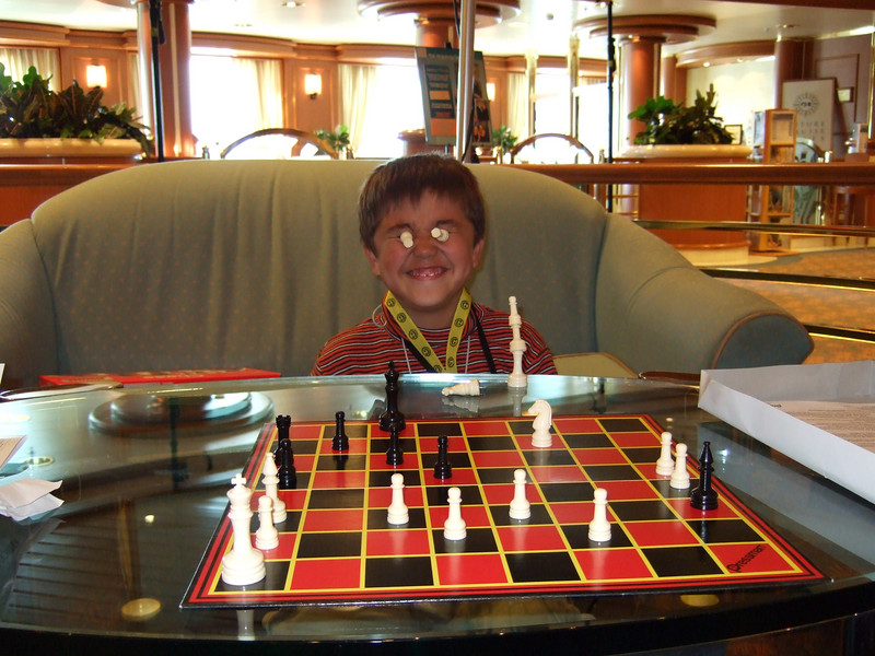 After the ship left the glaciers, Ethan and I had a nice friendly game of chess.  As you can see, he captured two of my pieces and began taunting me with them.
