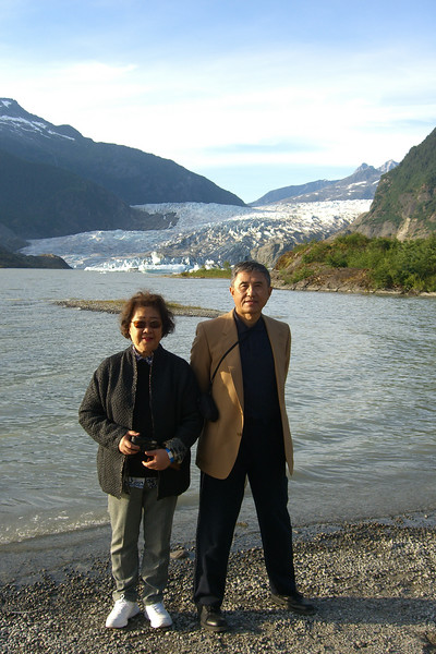 Mr. and Mrs. Li post by the Mendenhall Glacier.