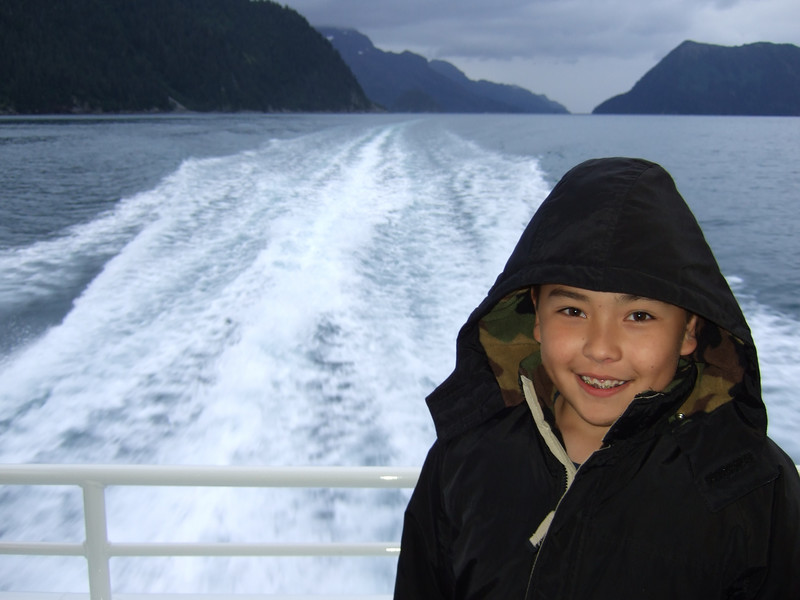 Austin poses near the back of the boat during a brief moment of relatively calm seas.