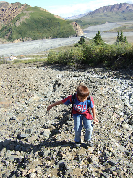 Ethan and I decided to get off the shuttle and go for a hike up a nearby mountain.  Here he is working his way up the gravel stream (glacier?) bed we followed up.