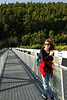 Eva pauses on a bridge over an inlet on our hike in Skagway.