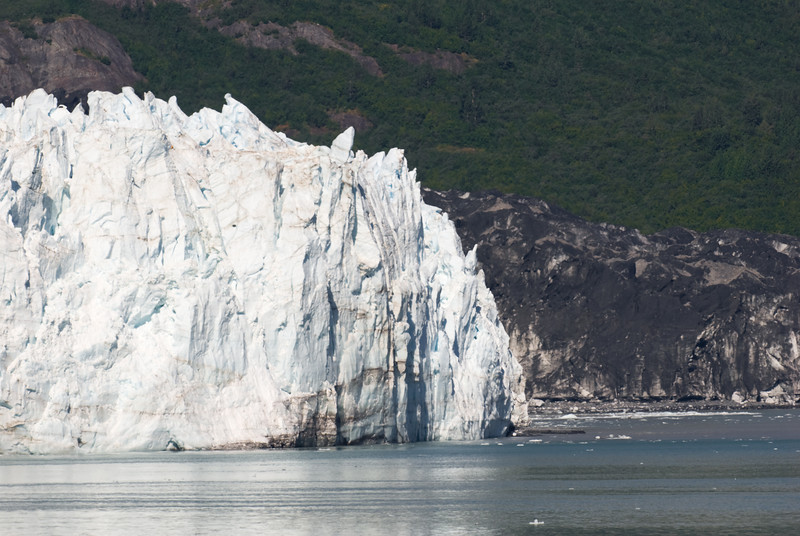 A glacier juts into the bay.