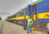 A happy set of passengers disembark at the Alaska Railroad terminal below C Street Bridge in Anchorage.