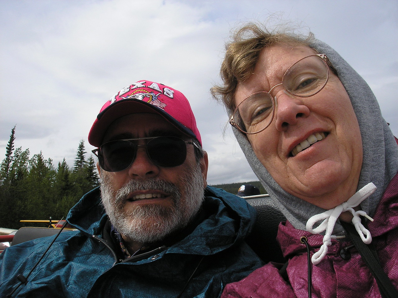 Here is a self portrait of John and I having fun on a rainy day in the town of Whitehorse, Yukon Territories, Canada.  We took a one hour cruise in the Yukon River.