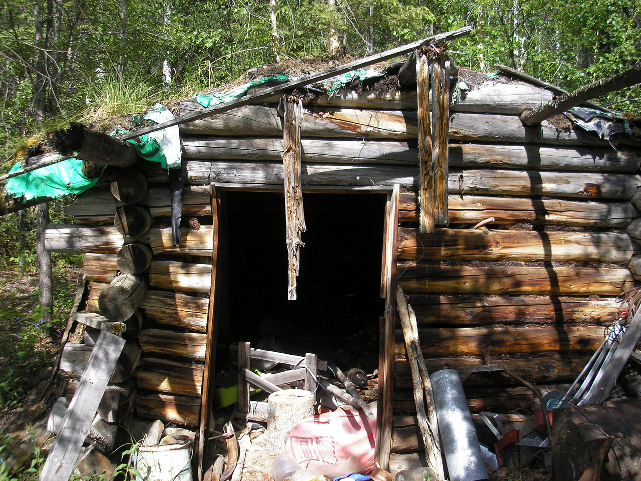 The cabin was very old and was abandoned with things inside.