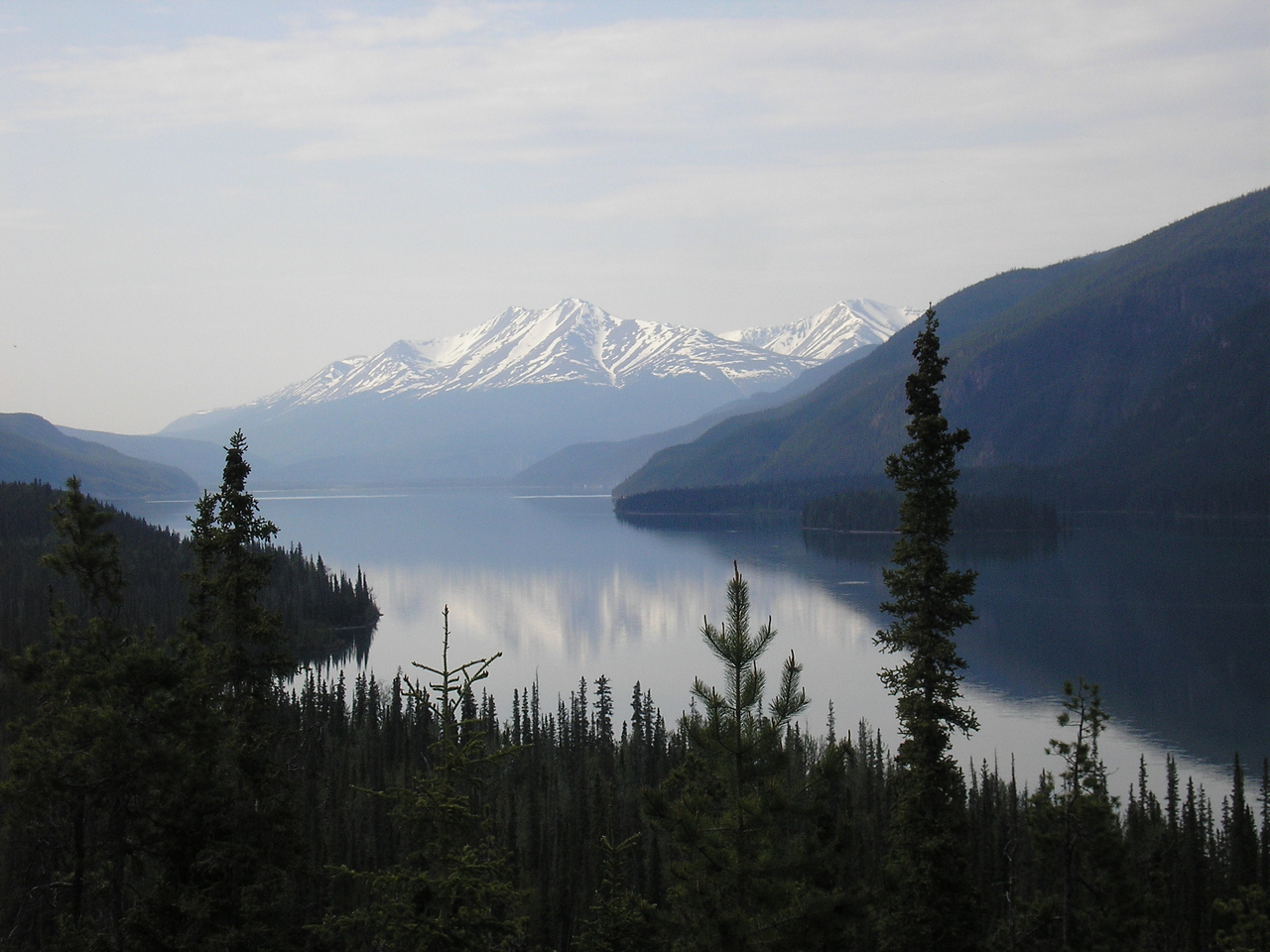 This is Muncho Lake with beiutiful mountians in the distance.