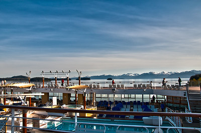 A view from the top of the Millennium cruise ship to the mountains in the background.