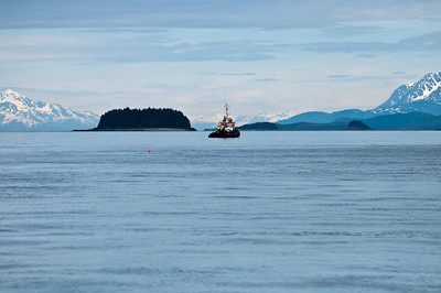 A fishing boat sails into the cool waters off Juneau.