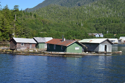 Near Ketchikan, Alaska. A former floating lumber town with clear-cut forresting behind.