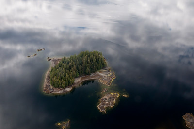An island in the clouds in Misty Fjords.  The water reflected the clouds above.