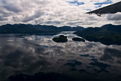 Reflections of clouds fall across the whole lake in Misty Fjords.