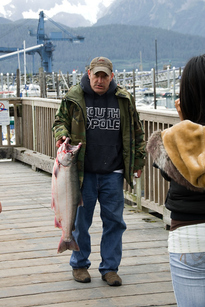 We arrived in Seward near the end of a salmon fishing derby.  While waiting on the pier, this guy came in from his boat, proudly displaying a large salmon.  He ended up winning the contest.