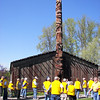 The group in front of the Wolf House Totem Pole.