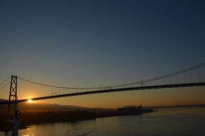 View of Vancouver, BC and the Lion's Gate Bridge at sunrise from the deck of Radiance of the Seas