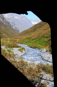 "View through hole in wall - Stamp Mill - Mineral Creek - Valdez - Alaska - USA  ""Part of Valdez's heritage is located 7 miles up beautiful Mineral Creek Canyon. Established as a result of gold fever, the same fever that gave birth to the town of Valdez, the Stamp Mill stands a tribute to the efforts of early miners to strike it rich.  The Stamp Mill then and now is state owned, but it was built by W.L. Smith during the summer and winter of 1913. It took a total of two men to work the stamp mill at all times.  During its first year of operation, the stamp mill produced 120 tons of ore and used only two stamps that weighed a total of 1,200 lbs.""  http://www.valdezalaska.org/history/stampMill.html"