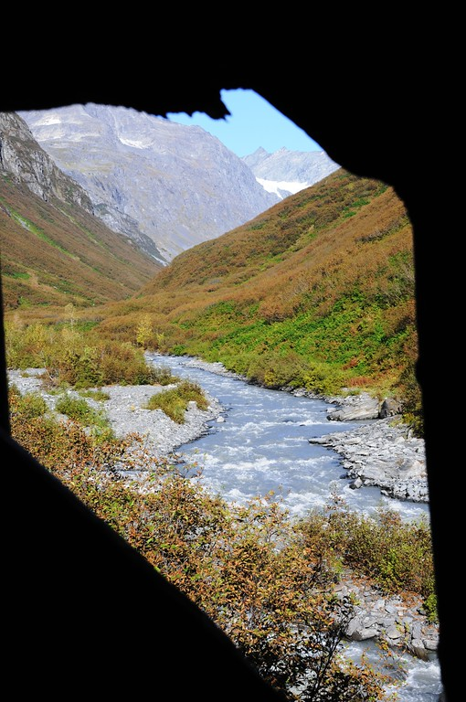 """View through hole in wall - Stamp Mill - Mineral Creek - Valdez - Alaska - USA<br /> <br /> """"Part of Valdez's heritage is located 7 miles up beautiful Mineral Creek Canyon. Established as a result of gold fever, the same fever that gave birth to the town of Valdez, the Stamp Mill stands a tribute to the efforts of early miners to strike it rich.<br /> <br /> The Stamp Mill then and now is state owned, but it was built by W.L. Smith during the summer and winter of 1913. It took a total of two men to work the stamp mill at all times.<br /> <br /> During its first year of operation, the stamp mill produced 120 tons of ore and used only two stamps that weighed a total of 1,200 lbs.""""<br /> <br />  <a href=""""http://www.valdezalaska.org/history/stampMill.html"""">http://www.valdezalaska.org/history/stampMill.html</a>"""