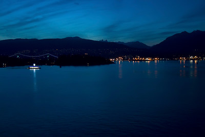 An evening view of the Lions Gate Bridge from Canada Place.