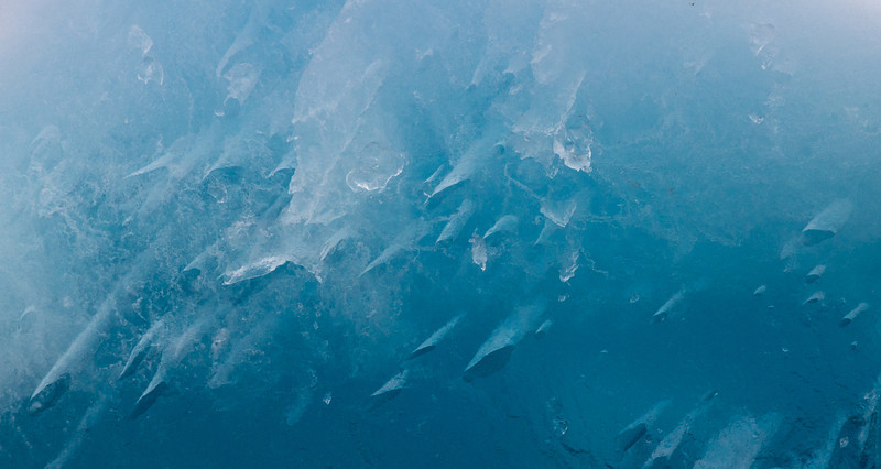 These interesting shapes formed in a flat sided iceberg we passed that stood maybe 12 to 15 feet out of the water.