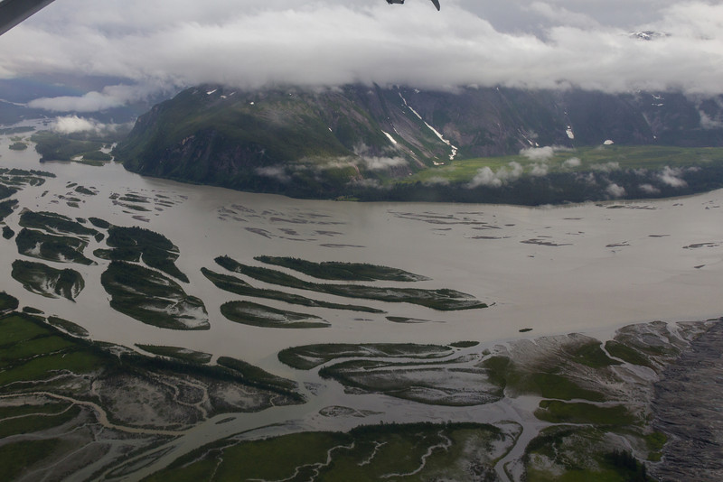 Taku River delta. The massive Taku Glacier's terminus is the darker lump at the lower right edge.