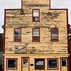 """Peeling paint on old building facade. SEE ALSO:    <a href=""""http://www.blurb.com/b/893025-north-to-alaska"""">http://www.blurb.com/b/893025-north-to-alaska</a>"""
