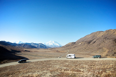 Denali Road Lottery, 2010 This image was made with a wide angle lens to better fit the vehicles in the foreground: it distorts by making the mountain look farther away.