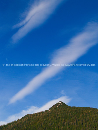 """Stunning contrasting Alaskan mountain against intense blue sky and stark white clouds. SEE ALSO:    <a href=""""http://www.blurb.com/b/893025-north-to-alaska"""">http://www.blurb.com/b/893025-north-to-alaska</a>"""