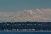 "Usually in clouds, the ""Mountain was out"" as the Seattle locals say when you can see Mt. Rainier from town. In 3 trips to Seattle we never saw it until this day. It is 60 miles away."