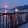 A full moon rises over the Gastineau Channel, Juneau, AK