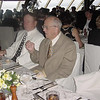 people we met on cruise the man on left an airline pilot-. dining area-one of many- way to much food on cruises.