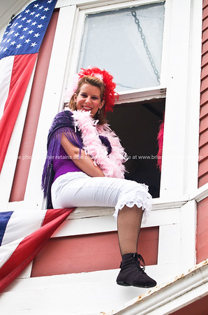 """Self promotion. Woman promotes evening show sitting in window.<br /> Model released; no, for editorial & personal use. SEE ALSO:    <a href=""""http://www.blurb.com/b/893025-north-to-alaska"""">http://www.blurb.com/b/893025-north-to-alaska</a>"""