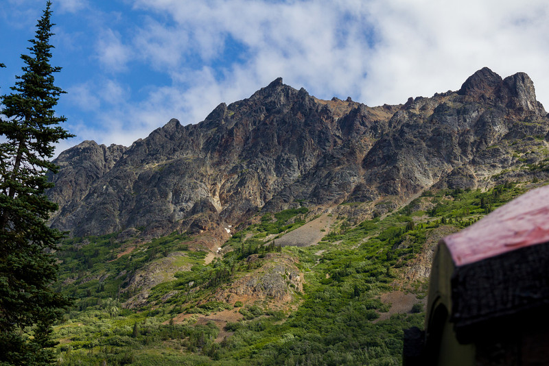 Mountains along the White Pass Railroad train tracks.