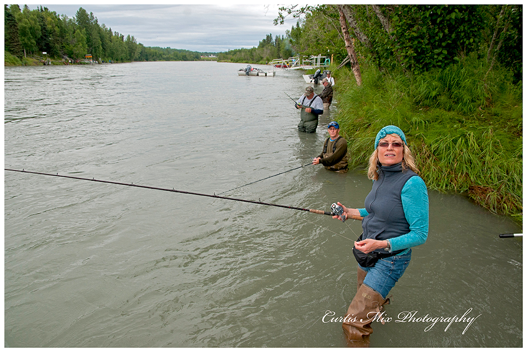 Susan combat fishing on the Kenai River.