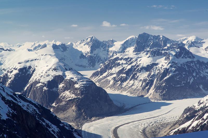 Merging glaciers showing debris lines (medial moraines)