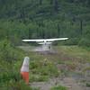 Piper Supercub touchdown on Majestic Valley Lodge landing strip