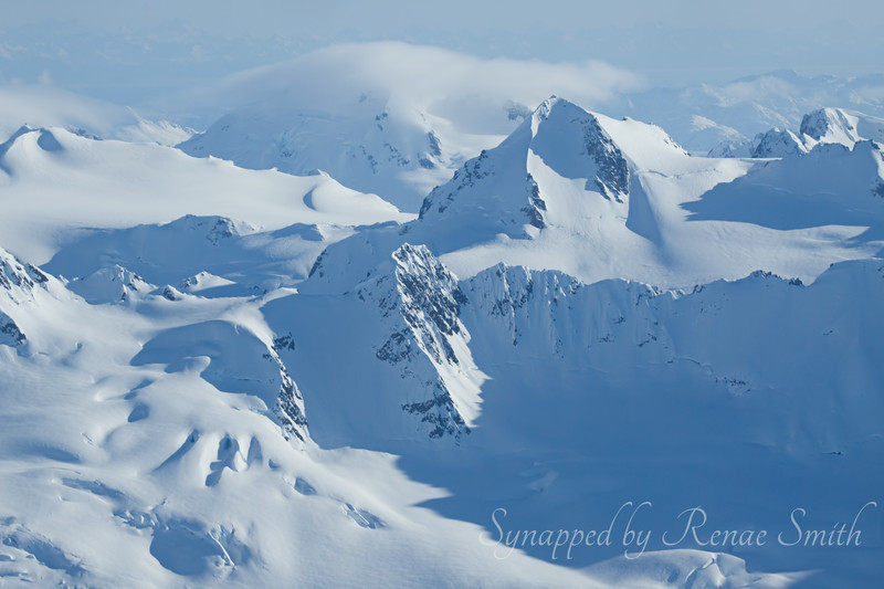 Somewhere in the Alaska mountain range (look closely for the ghost layer of mountains)
