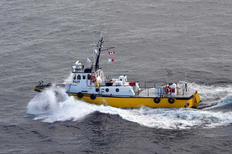 (73)  Pilot boat guided us through a mountain passage.