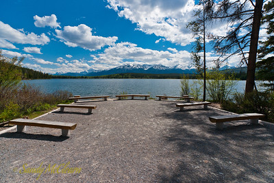 Benches on Pyramid Island look in the general direction of Mount Edith Cavell.