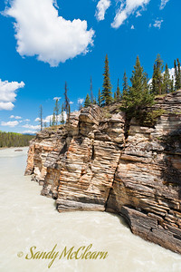 A rock face along the river below Athabasca Falls.