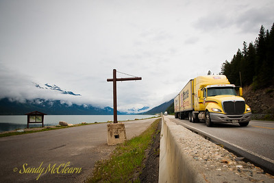 A transport truck travels along Moose Lake on its way towards Jasper.
