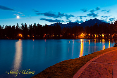 Moonrise over Lac Beauvert with Pyramid Mountain in the background.