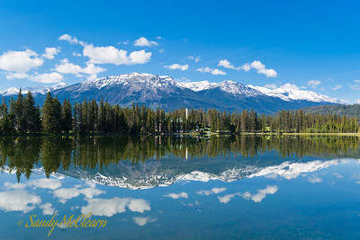Mountains reflected on Lake Mildred at Jasper Park Lodge.