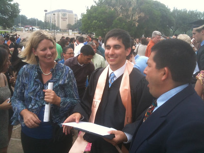 Proud parents Jennifer and Claudio with new grad Alex!